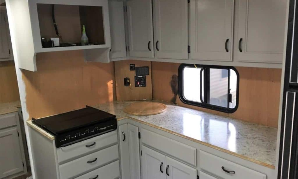Sink with Cutting Board Cover Installed in updated laminate counter top