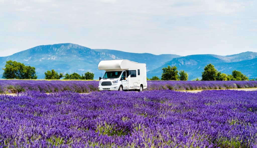 Campervan moving through a lavender field in Provence, France